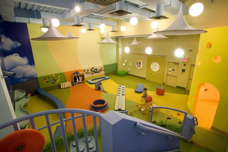 Colorful indoor play ground with custom print impact attenuation carpeting.