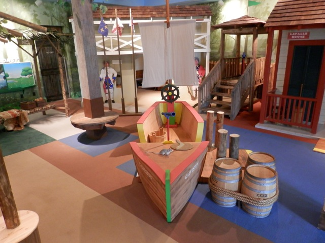 Custom sheet vinyl indoor play ground flooring that is shipped themed complete with a boat to play in and a sail. This sheet vinyl flooring is antimicrobial and is safe playground flooring.