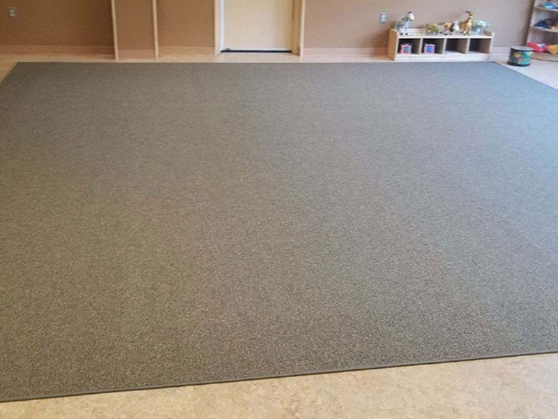 SafetyRug installed in indoor play space with taper edges that meet ADA requirements.