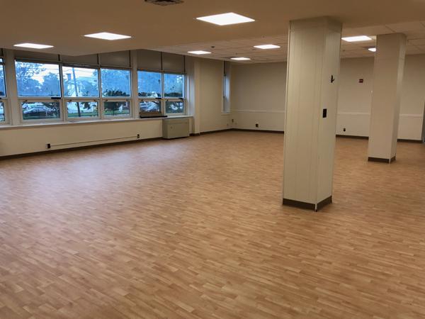 Wood grain sheet vinyl safe flooring for children in a child development center.
