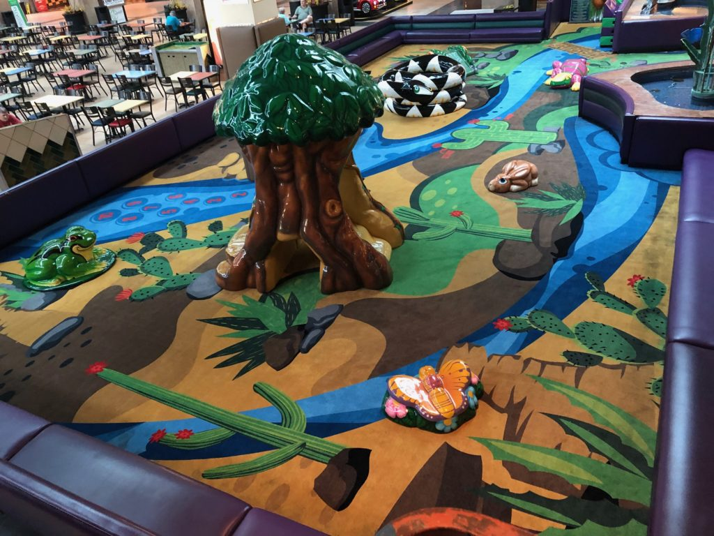 Southwestern designed custom carpeting with indoor playground equipment and SafeLandings protective flooring installed in a shopping mall.