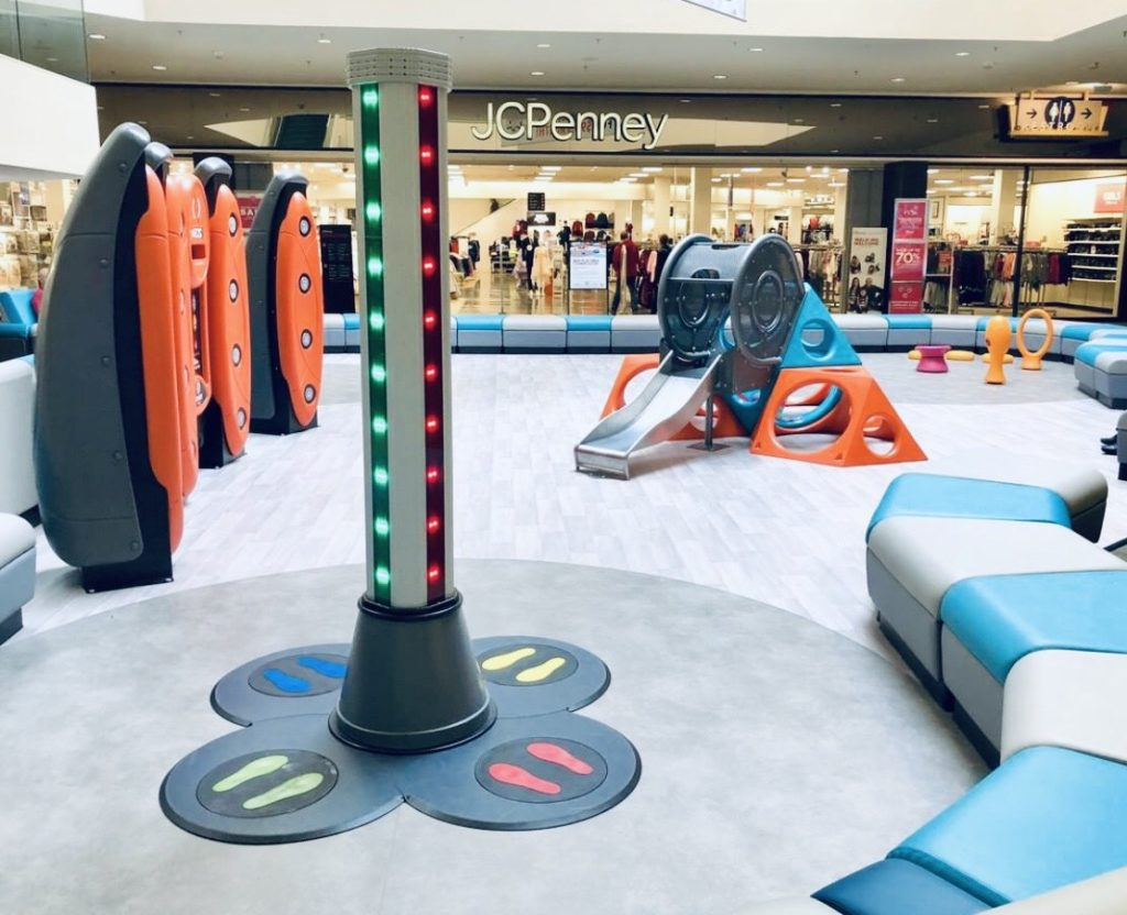 Custom resilient sheet vinyl SafeLandings flooring installed in shopping mall play area.