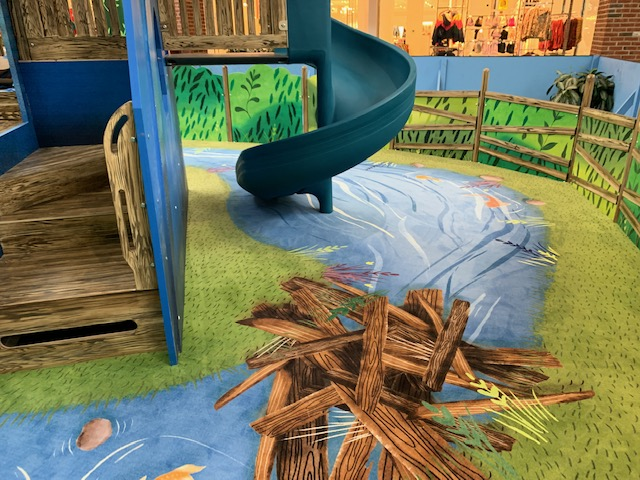 Custom printed carpet with beaver dam at a indoor fall rated mall carpet play area.