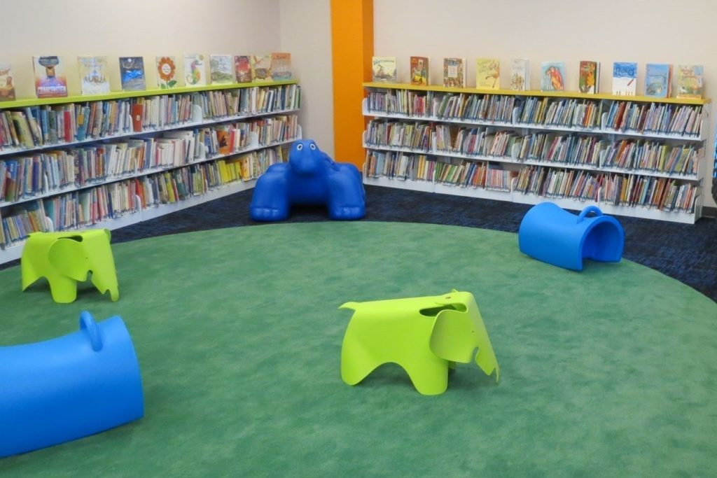 Indoor fall preventing carpeting at library children's room.